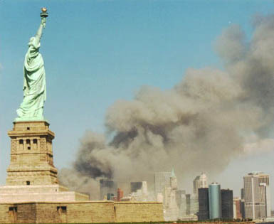 National_Park_Service_9-11_Statue_of_Liberty_and_WTC[1]