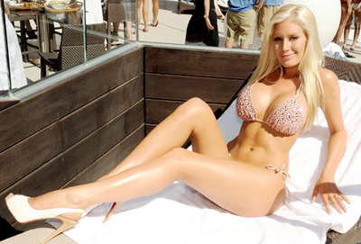E Cup Breast Implants Photos http://www.lovelyish.com/725675803/heidi-montags-breast-implants-might-erode-through-her-skinew/